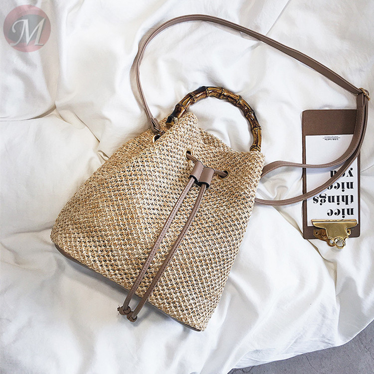 0270406 Hot sale 2020 hollow solid color bucket simple Best Cross Body Straw plaiting Lady bag handbag