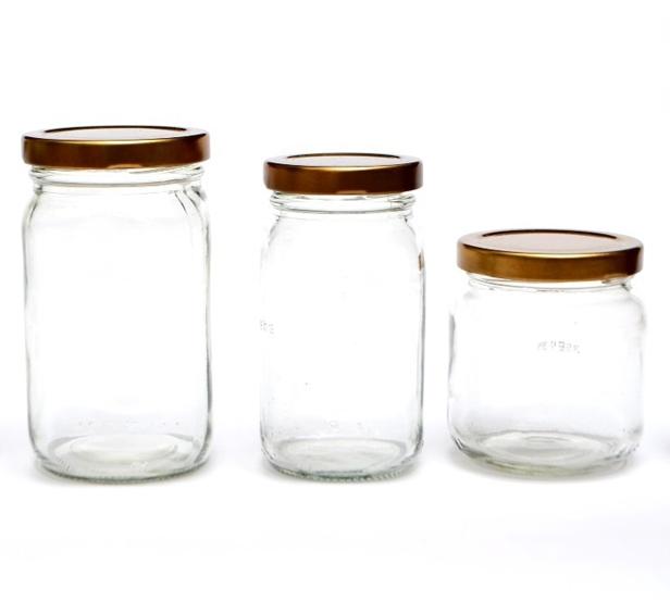 Wholesales Frascos डे Vidrio चोर तप पैरा Miel ग्लास अचार जाम जेली शहद जार भंडारण की बोतलें