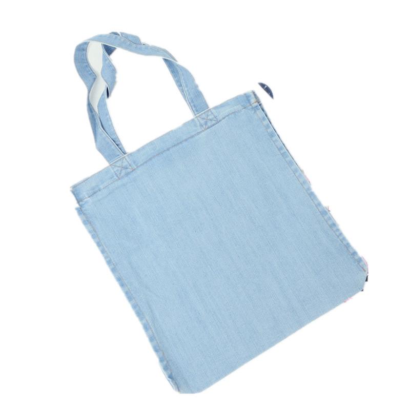 Venta al por mayor bolsas de mezclilla para dama Compre