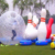 Custom Inflatable Human Bowling Ball Outdoor Lawn And Snow Land Sport Game Huge Inflatable Blowing Pins