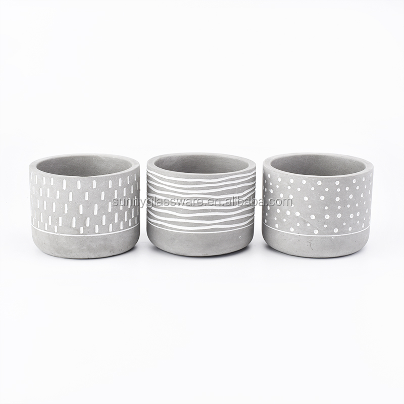 gray concrete candle holders