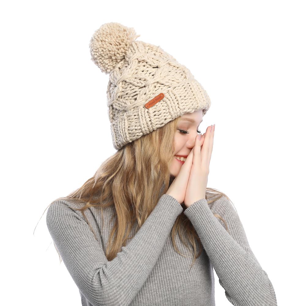wholesale leather logo slouch messy bun women fashion crochet outdoor warm winter knit pom pom beanie hats