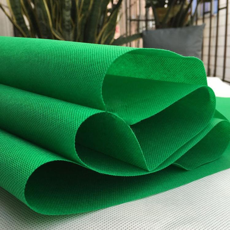 Fabrika promosyon fiyat sıcak satış renkli tıbbi kumaş lab coat spunlace 40gsm dokumasız malzeme çanta