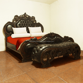 Wooden carved bed design with dragon sculpture and sutudded leather upholstered
