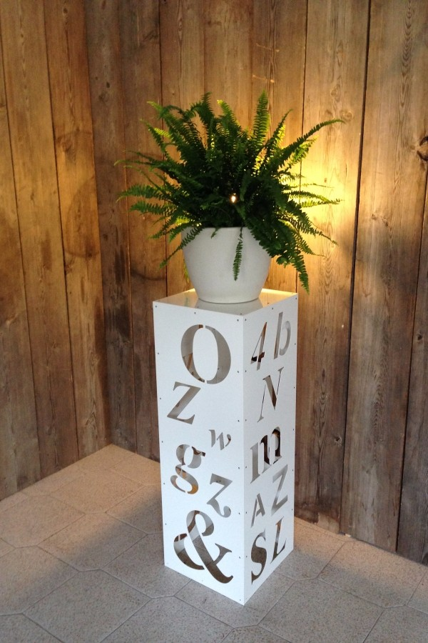 A carved square base column in cor-ten steel with half ball vase, HandMade in Italy