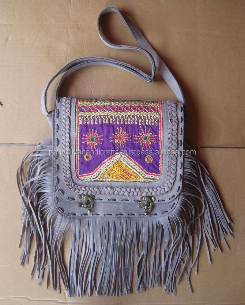 An Incredibly stunning hand made one of a kind suede leather Banjara tribe handbag.