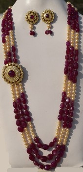 Latest design round kundan polki pendant side tikda with earrings in latest design round kundan polki pendant side tikda with earrings in gold with pearl ruby beads aloadofball Images