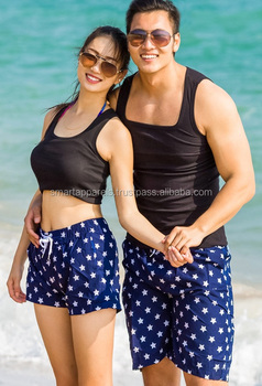 unisex shorts couple on beach blue color