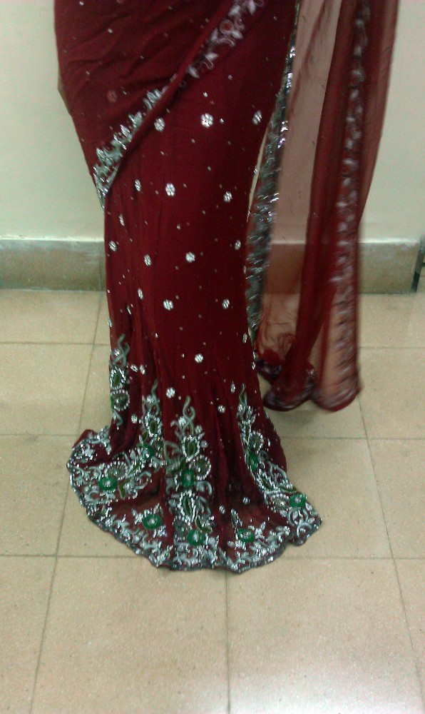 Easy-wear stitched saree with ready-made Blouse. Red Georgette stone work