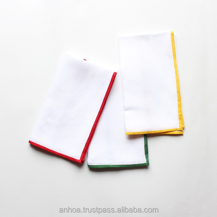 White Linen Dinner Napkin With Red Green Yellow Color Border