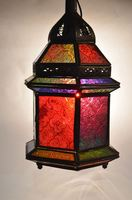Iron traditional lantern , decorated with rainbow colored glass