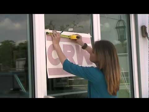 bestbuysignscom applying vinyl lettering to a glass door