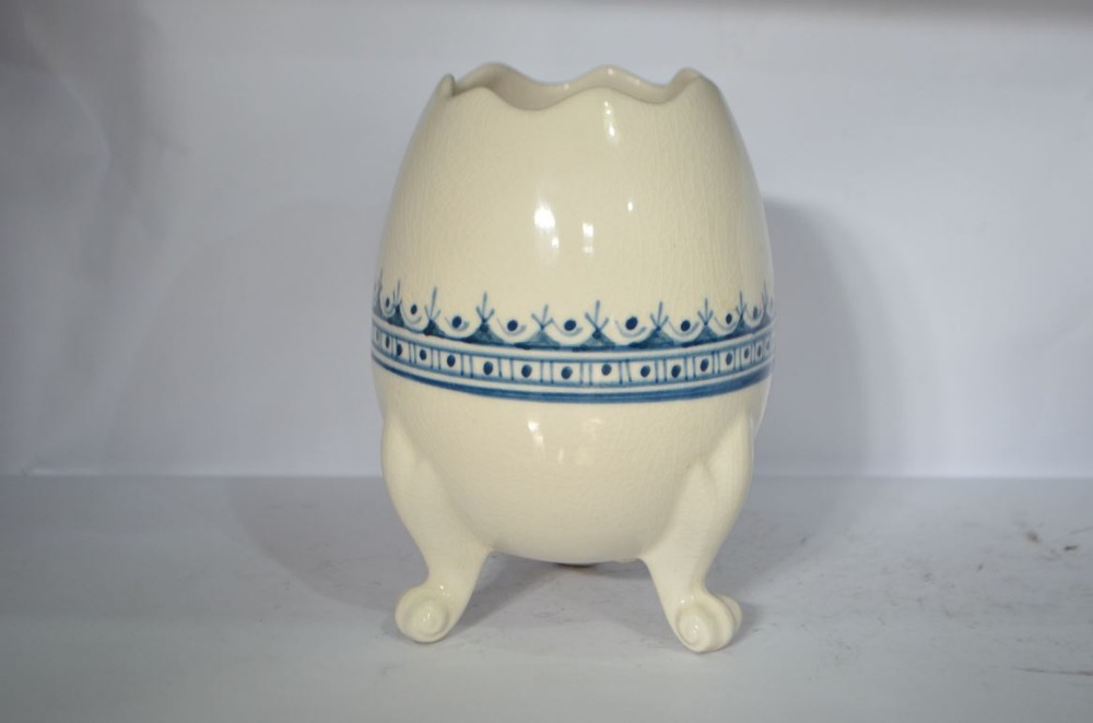 Egg shaped table decoration, made of pottery