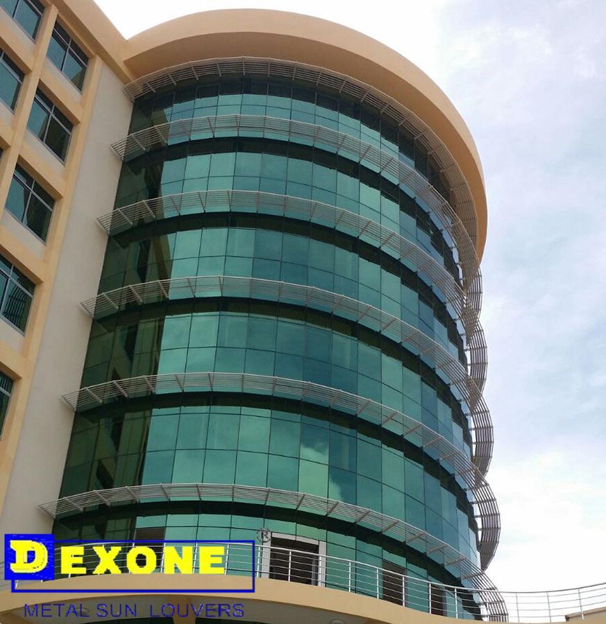 Glass Louver Facade : Aluminum louver sun shade fixed on glass construction