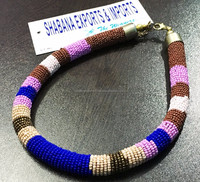 Ethnic braided pendant Tribal Indian beaded jewelry