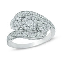 1 CT. T.W. Diamond Frame Three Stone Bypass Ring In 10K White Gold 1/3 CT. T.W. Diamond Twist Shank Bridal Set In 10K