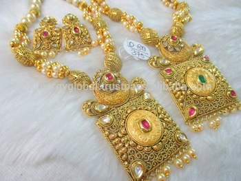 bridal floral polki embellished heavy emeralds motifs mango gold with studded designs two antique stones necklace over paired theme jewellery all paisley step