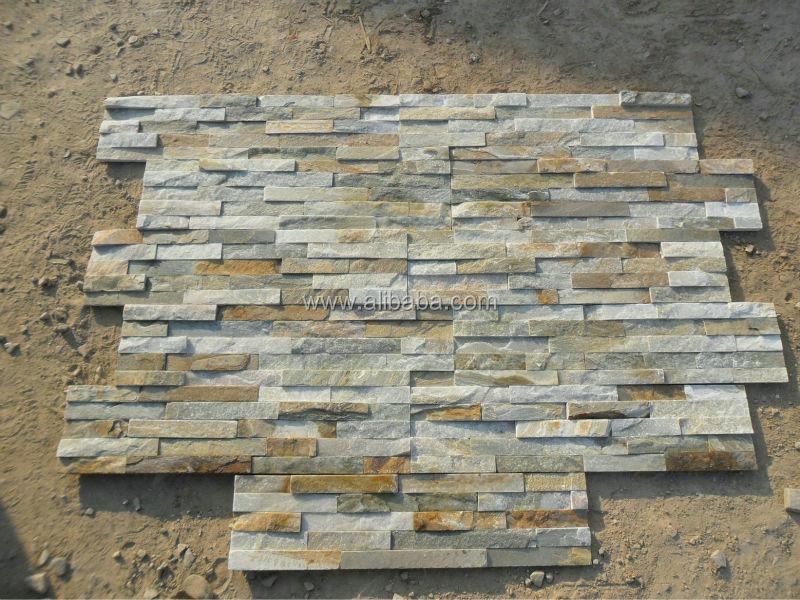 A muro esterno di piastrelle di pietra di forma e colore giallo