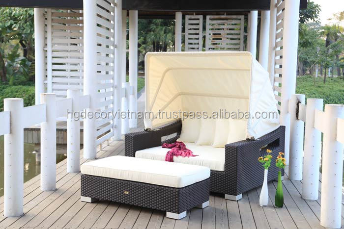Plastic rattan sun lounger with sunbrella cushion for project, resort and hotel