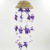 WIND CHIME MADE OF SEASHELLS WITH A COLOR COMBINATION OF PURPLE AND WHITE