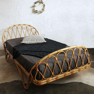 Relaxing and sturdy vintage rattan day bed, handcrafted in Vietnam