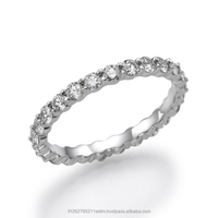 18K Gold All Around Eternity Ring set with 25 White Diamonds of 1Carat, set in Prong setting technique.