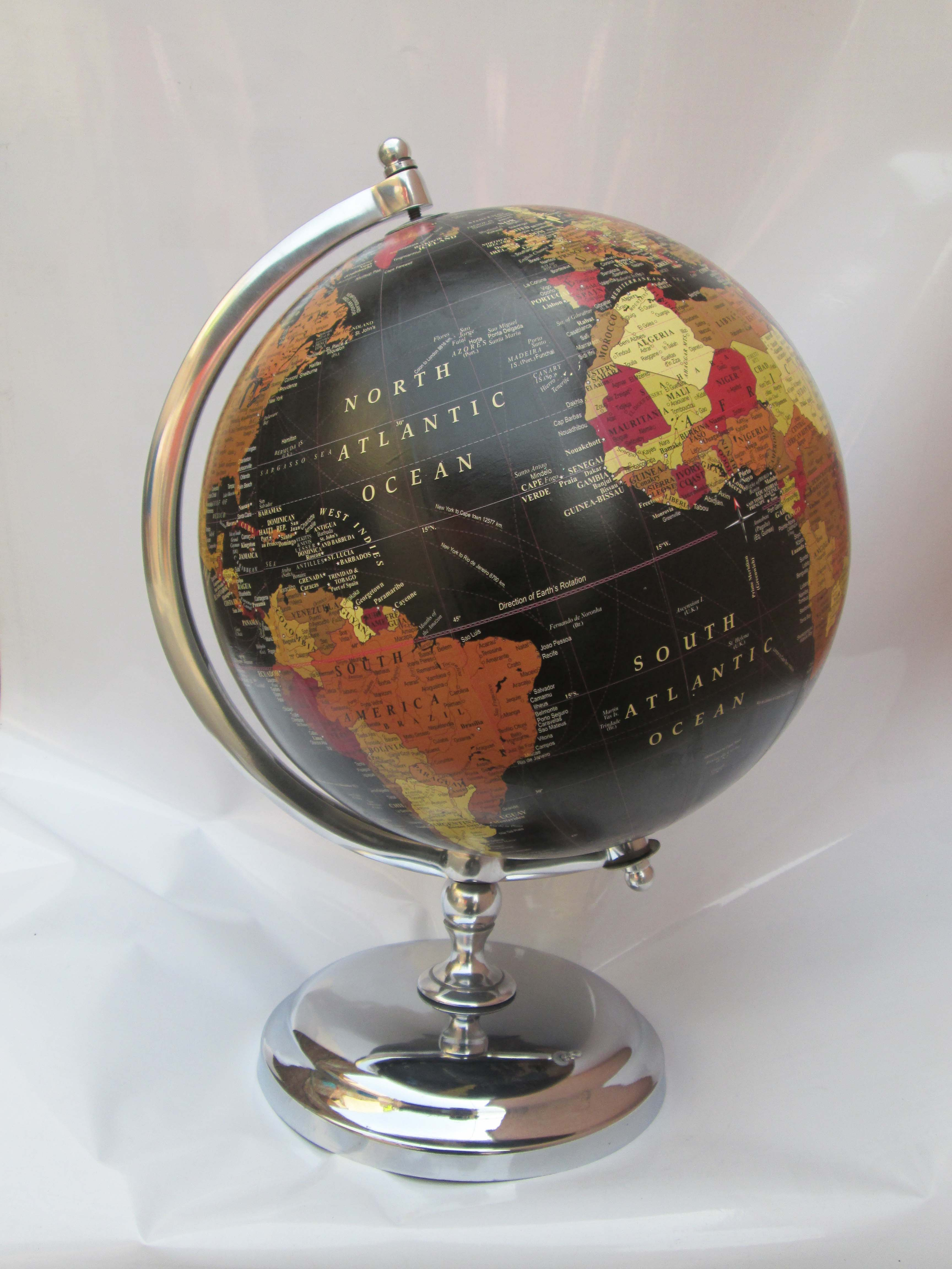 desk globe with worldwide sea route air route details