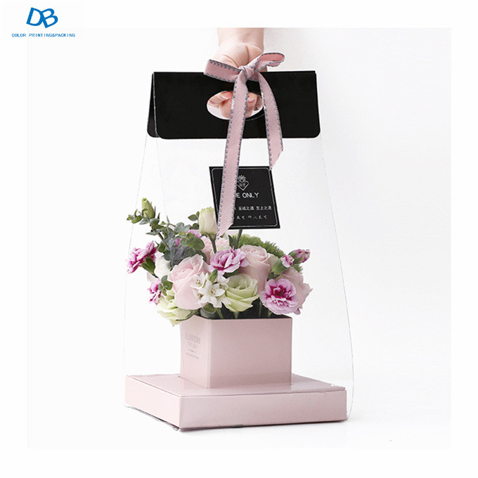 Cardboard black cone flower gift box with ribbon handle