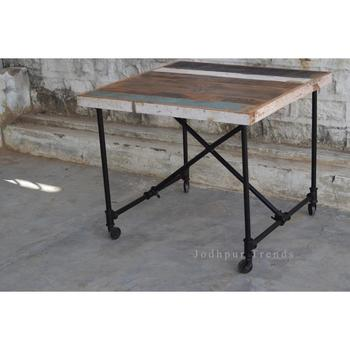 vintage restored folding Dining table supplier / industrial iron and reclaimed wooden furniture With Wheels