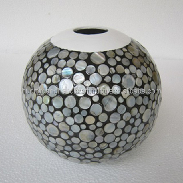 Round lacquer vase with full of round pieces seashell covered