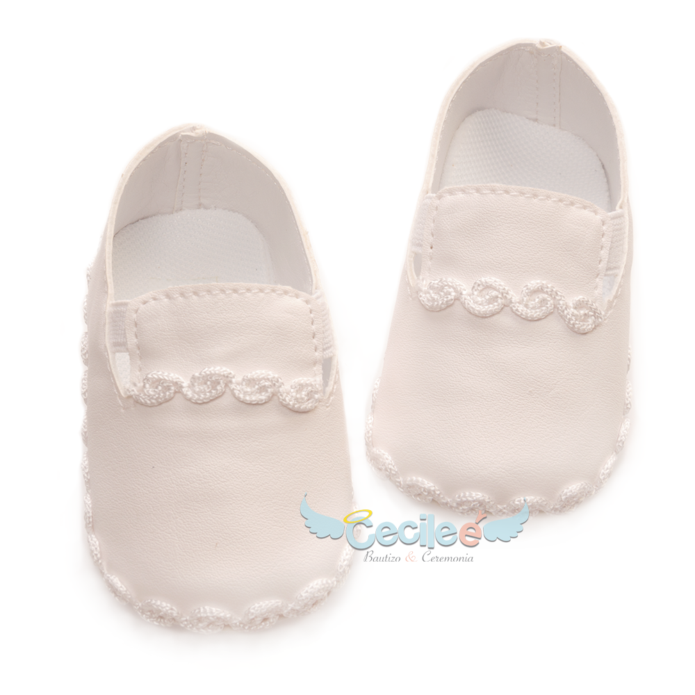 Beautiful and elegant shoe for child with lace for the christening of your baby