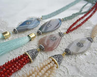 multi color, red, blue, green, gray agate long boho tassel necklaces.