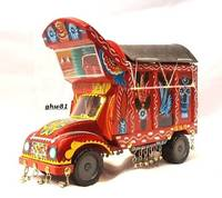 Pakistani Wooden fancy truck All work done on the wooden truck is handmade and real truck art.