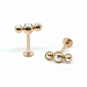 Custom rose gold jewelry of 16g triple gems labret piercing